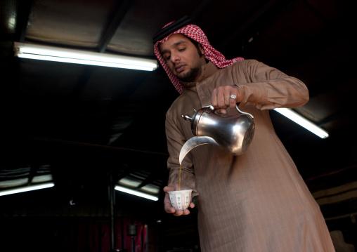Portrait of a saudi man serving coffee, Al-Jawf Province, Sakaka, Saudi Arabia