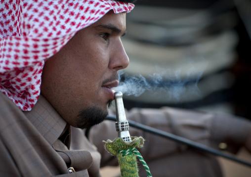 Saudi man smoking shisha, Al-Jawf Province, Sakaka, Saudi Arabia