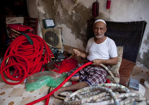 Old man making shishas in a shop, Mecca province, Jeddah, Saudi Arabia