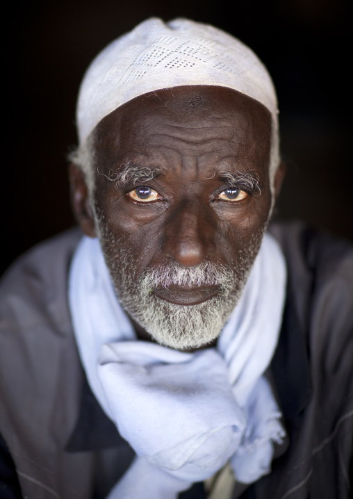 Portrait of man wearing a white beard and hat, Baligubadle, Somaliland