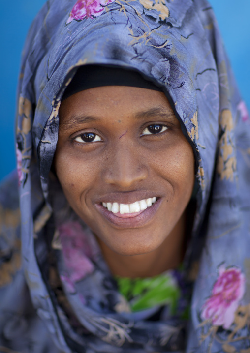 Smiling portrait of a beautiful woman wearing a patterned heardscarf, Boorama, Somaliland