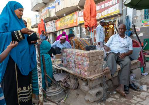 Wads of money changer on his stall , Woqooyi Galbeed region, Hargeisa, Somaliland