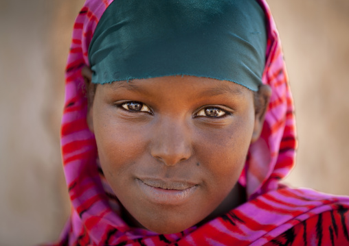 Portrait of a smiling girl wearing a pink veil,  Degehabur, Somaliland