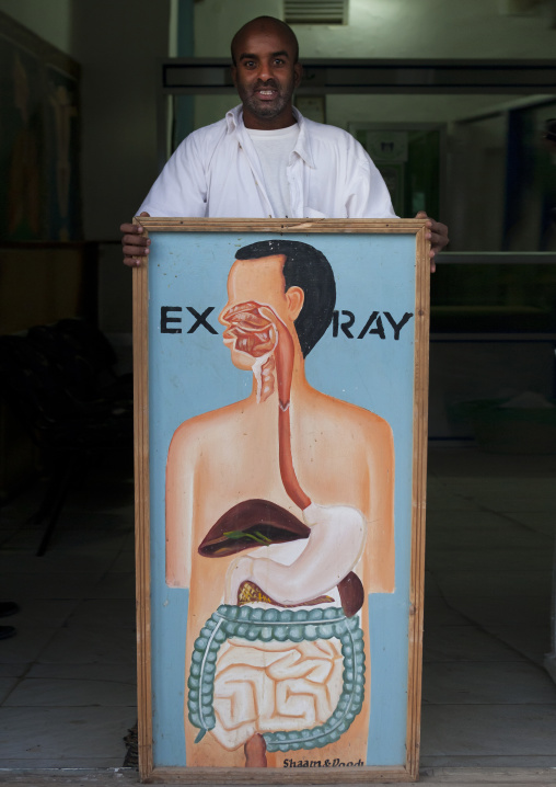 A Doctor Posing With XRay Painted Advertisment, Hargeisa, Somaliland