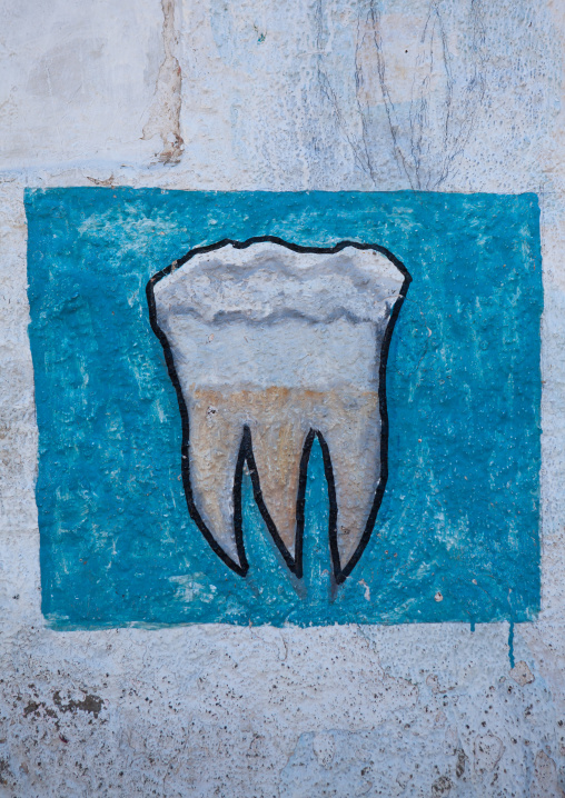 A painted advertisement sign for a dentist, Woqooyi galbeed region, Hargeisa, Somaliland