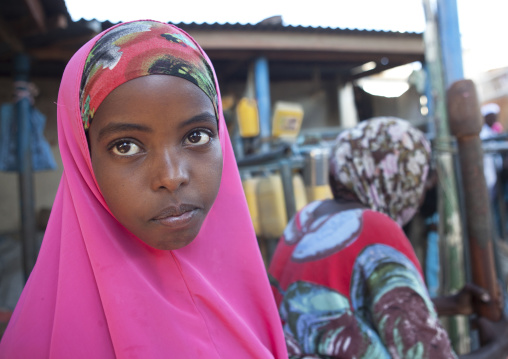 Portrait of a thoughtful teenage girl wearing a flashy pink hijab, Boorama, Somaliland
