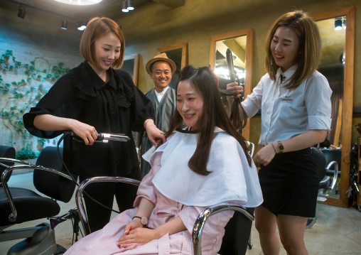 North korean defector joseph park with his south korean fiancee juyeon in a beauty saloon, National capital area, Seoul, South korea