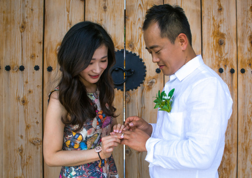 North korean defector joseph park putting wedding ring on the finger of his south korean fiancee juyeon, Sudogwon, Paju, South korea