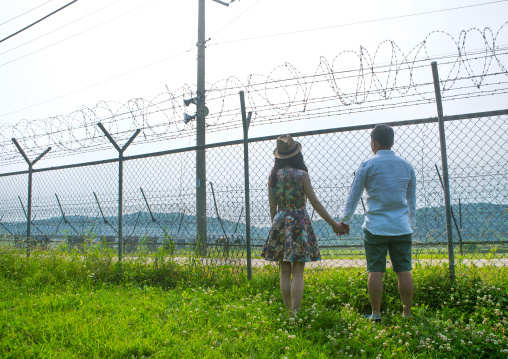 North korean defector joseph park with his south korean fiancee juyeon on the north and south korea border, Sudogwon, Paju, South korea