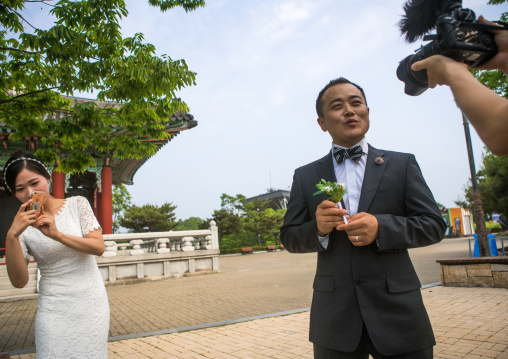 North korean defector joseph park with his south korean fiancee recording a video on the dmz, Sudogwon, Paju, South korea