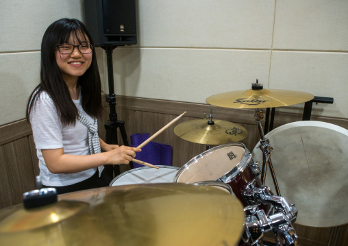 North korean teen defector in yeo-mung alternative school playing drums, National capital area, Seoul, South korea