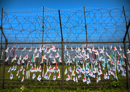Messages of peace and unity written on ribbons left on fence at DMZ, North Hwanghae Province, Panmunjom, South Korea