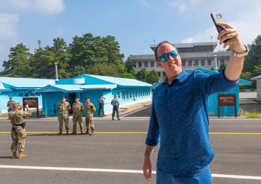 Tourist taking a selfie in the joint security area on the border between the two Korea, North Hwanghae Province, Panmunjom, South Korea