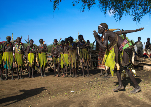 Toposa tribe women in traditional clothing dancing during a ceremony, Namorunyang State, Kapoeta, South Sudan