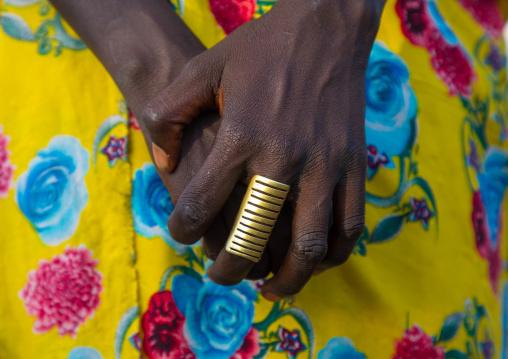 Toposa tribe rings on the fingers of a woman, Namorunyang State, Kapoeta, South Sudan