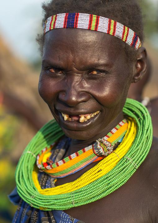 Portrait of a smiling Toposa tribe woman, Namorunyang State, Kapoeta, South Sudan