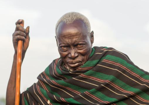 Toposa tribe senior man with a wood stick, Namorunyang State, Kapoeta, South Sudan