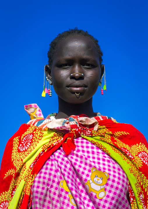 Portrait of a Larim tribe woman with eaerrings and Nose earrings, Boya Mountains, Imatong, South Sudan
