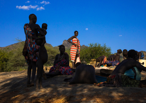 Larim tribe women resting after grinding, Boya Mountains, Imatong, South Sudan