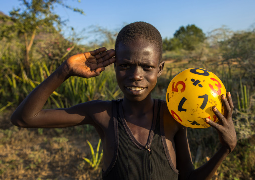 Portrait of a Larim tribe boy saluting with the hand, Boya Mountains, Imatong, South Sudan