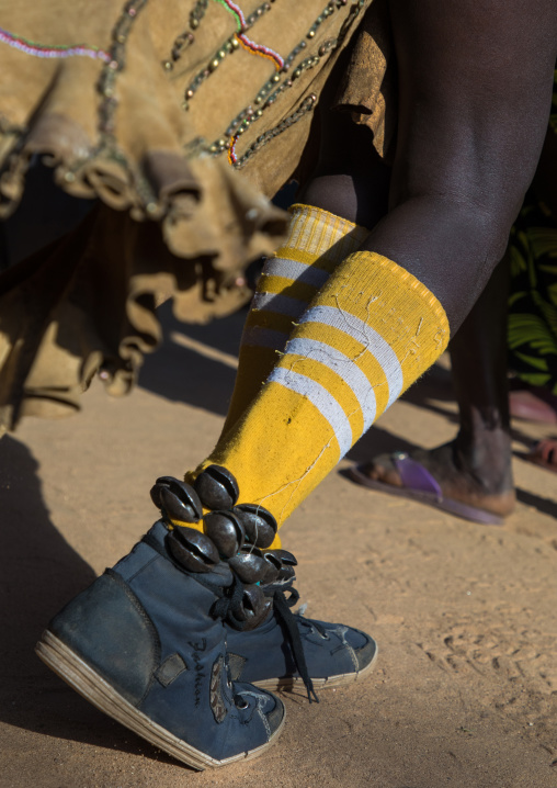 Bells on the shoes of a Larim tribe woman during a wedding ceremony, Boya Mountains, Imatong, South Sudan