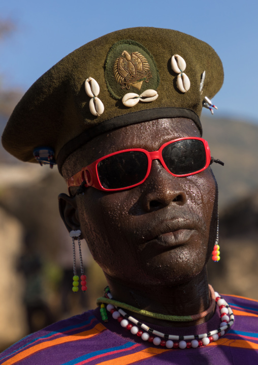 Larim tribe man with sunglasses during a wedding ceremony, Boya Mountains, Imatong, South Sudan