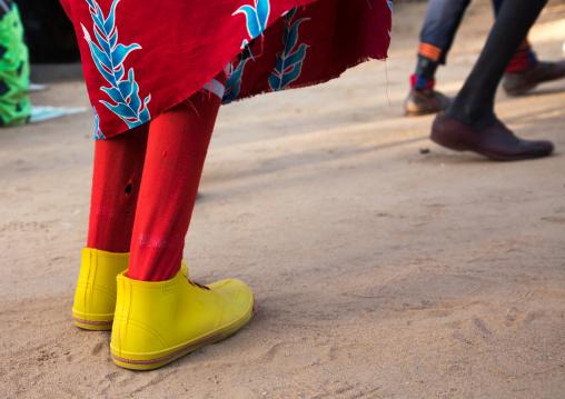 Larim tribe woman with yellow shoes dancing during a wedding celebration, Boya Mountains, Imatong, South Sudan