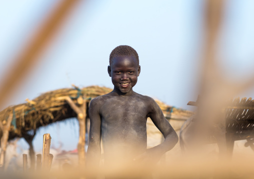 Smiling Mundari tribe boy in a cattle camp, Central Equatoria, Terekeka, South Sudan