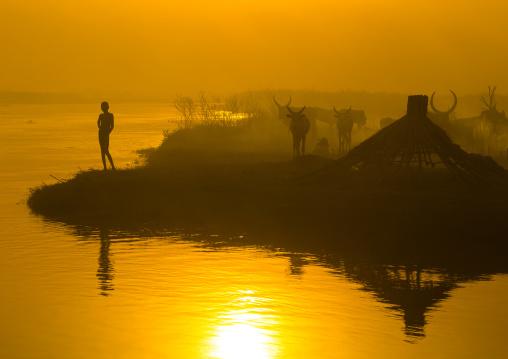 Mundari tribe child on the bank of river Nile at sunset, Central Equatoria, Terekeka, South Sudan