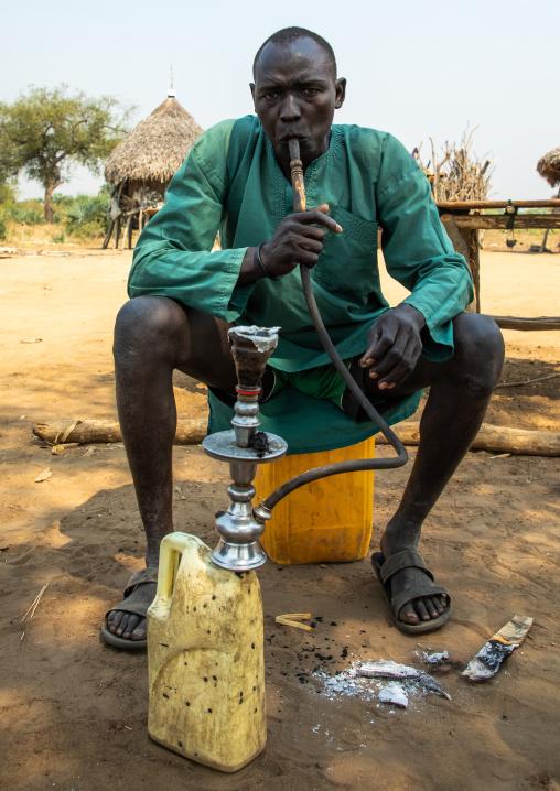 Mundari tribe man smoking shisha, Central Equatoria, Terekeka, South Sudan