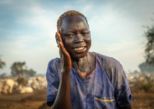 Mundari tribe boy showering with cow urine to take advantage of the antibacterial properties, Central Equatoria, Terekeka, South Sudan