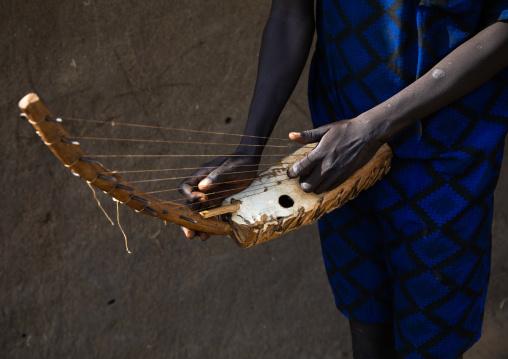 Mundari man playing local chordophone, Central Equatoria, Terekeka, South Sudan
