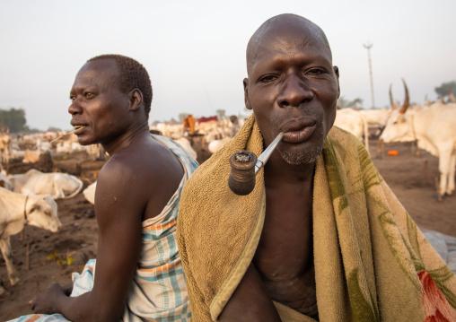 Mundari tribe man smoking a pipe, Central Equatoria, Terekeka, South Sudan