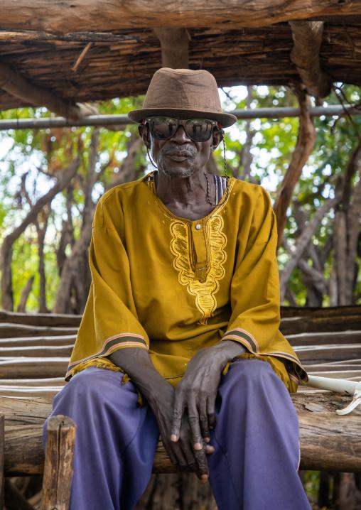 Old Lotuko tribe man wearing sunglasses and a hat, Central Equatoria, Illeu, South Sudan