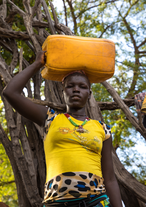 Portrait of a Lotuko tribe woman carrying a yellow jerrican on the head, Central Equatoria, Illeu, South Sudan