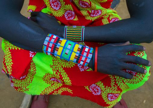 Larim tribe man with big beaded bracelets, Boya Mountains, Imatong, South Sudan