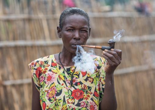 Portrait of a Larim tribe woman smoking a pipe, Boya Mountains, Imatong, South Sudan