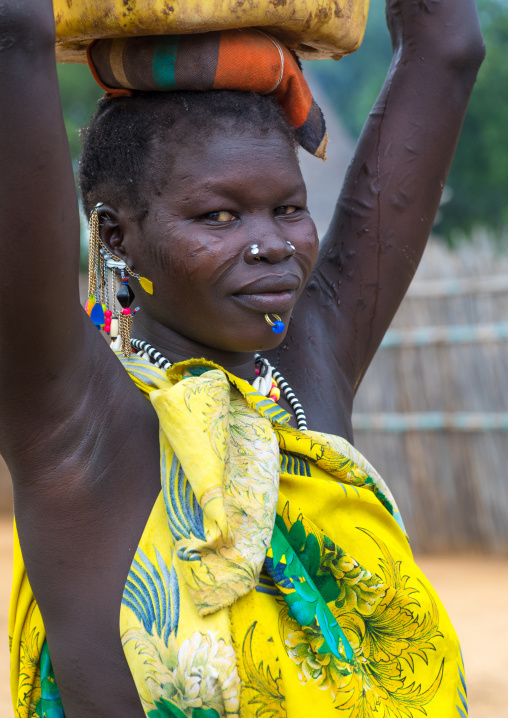 Portrait of a Larim tribe woman carrying a yellow jerrican on the head, Boya Mountains, Imatong, South Sudan