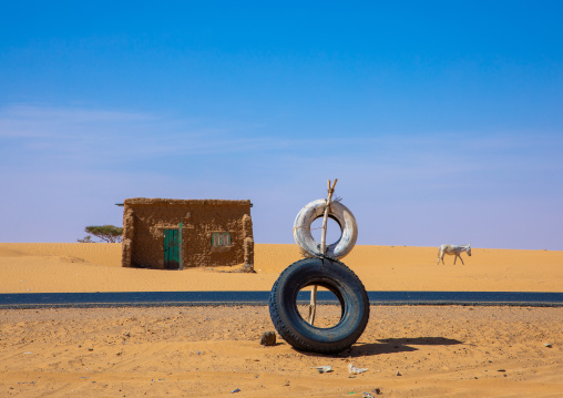Tyres along the road to indicate a garage, Khartoum State, Khartoum, Sudan