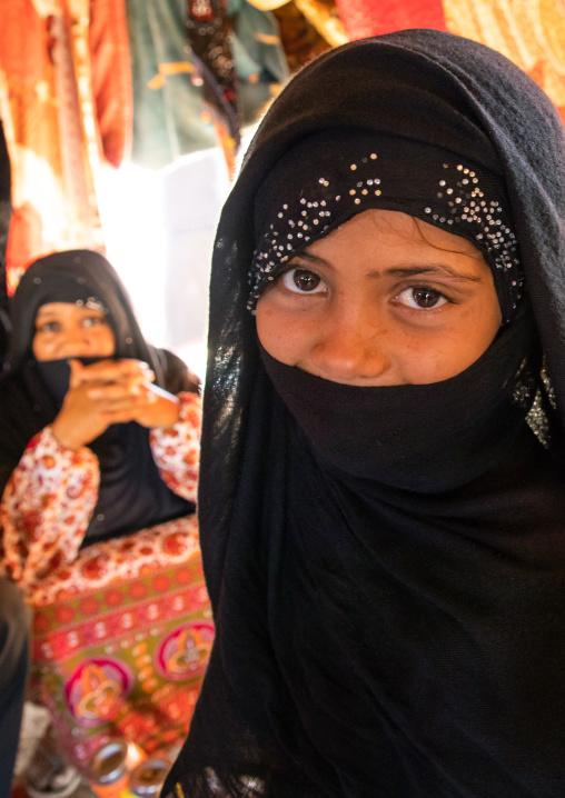 Portrait of Rashaida tribe veiled girl inside her tent, Kassala State, Kassala, Sudan