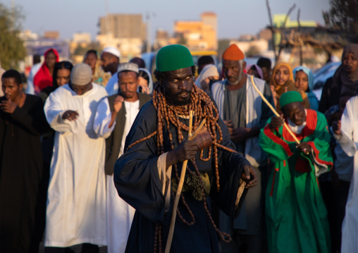 Sufi man with huge necklaces during the friday celebration at sheikh Hamad el Nil tomb, Khartoum State, Omdurman, Sudan