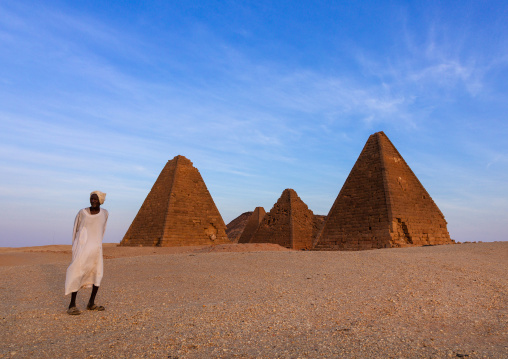 Old sudanese man in front of the meroitic pyramids of jebel Barkal, Northern State, Karima, Sudan