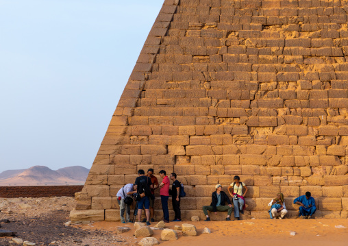 Tourists at the bottom of the pyramids of the kushite rulers at Meroe, Northern State, Meroe, Sudan