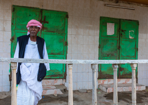 Sudanese man on the balcony of his house, Red Sea State, Suakin, Sudan