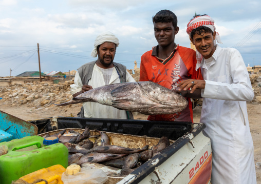 Fishermen with a big fish they catched, Red Sea State, Suakin, Sudan