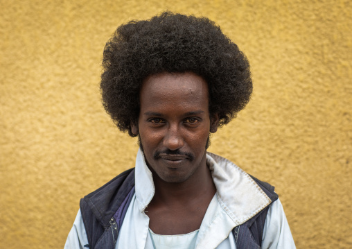 Portrait of a Beja tribe man with afro haircut, Red Sea State, Port Sudan, Sudan