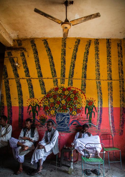 Beja tribe men smoking water pipes, Red Sea State, Port Sudan, Sudan