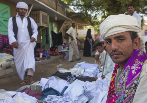 Sudan, Kassala State, Kassala, rashaida tribe men selling clothes