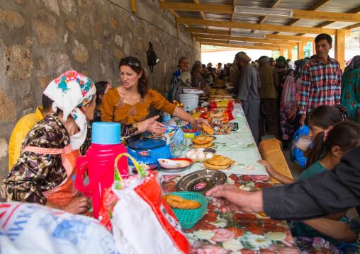 Tajik women selling food in the market border with Afghanistan, Central Asia, Ishkashim, Tajikistan