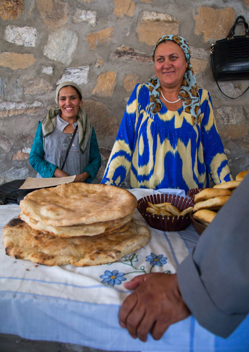 Tajik women selling bread in the market border with Afghanistan, Central Asia, Ishkashim, Tajikistan